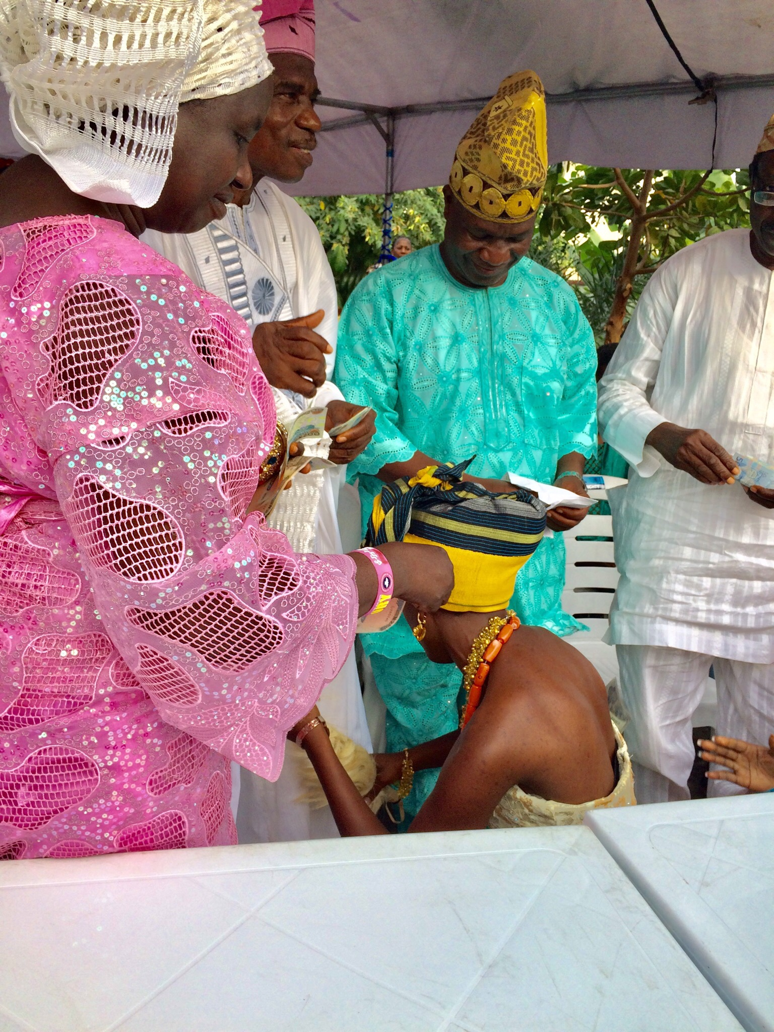 Groom's (Deji's) parents spraying money on the bride (Kedono, Jummai)