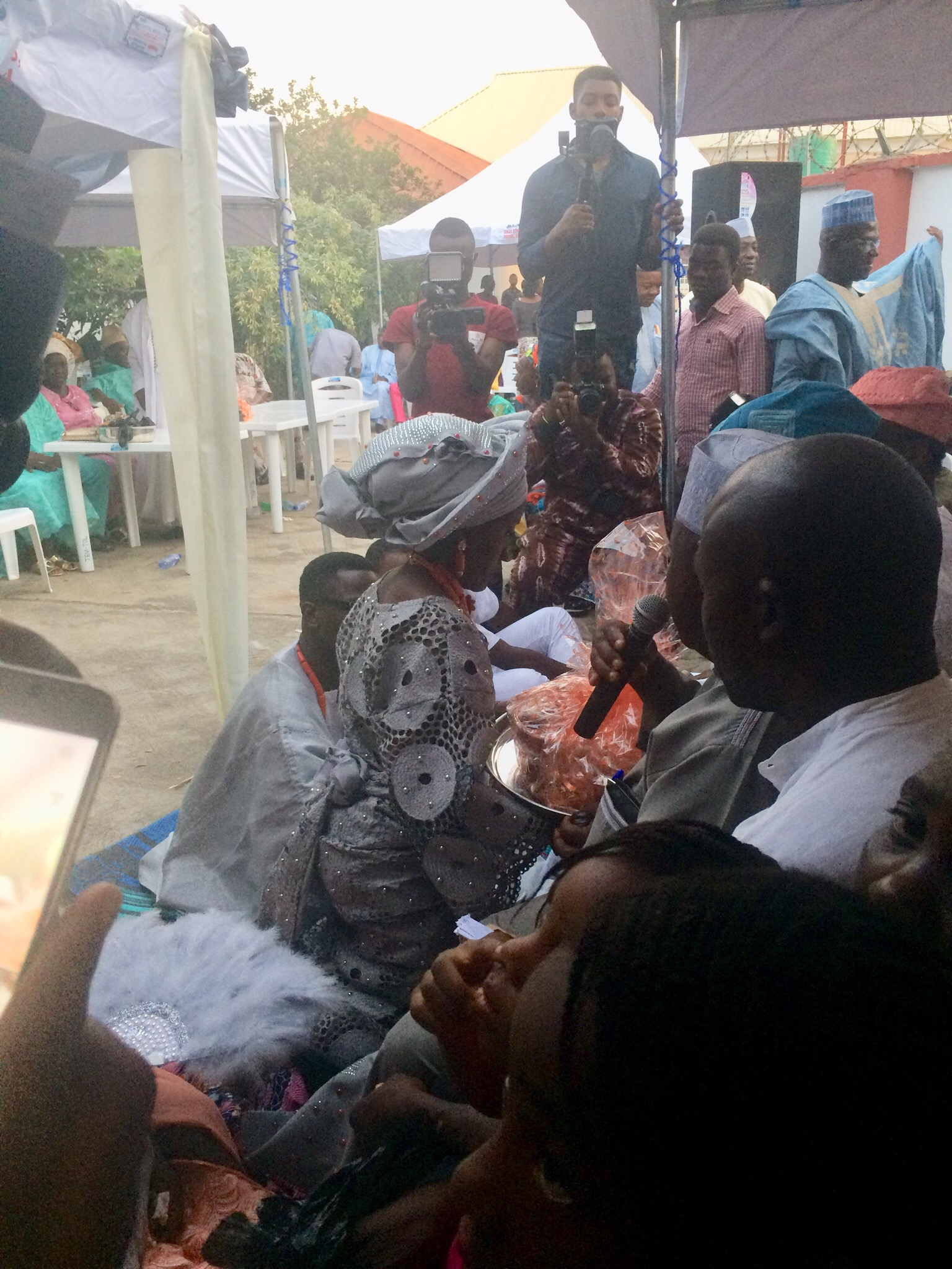 Bride presenting Kolanut from the groom's family to her Dad and her family
