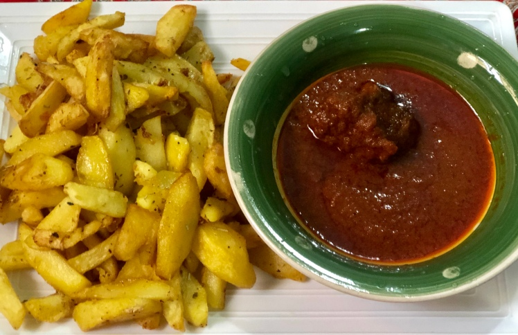 Fried potatoes with stew and meat