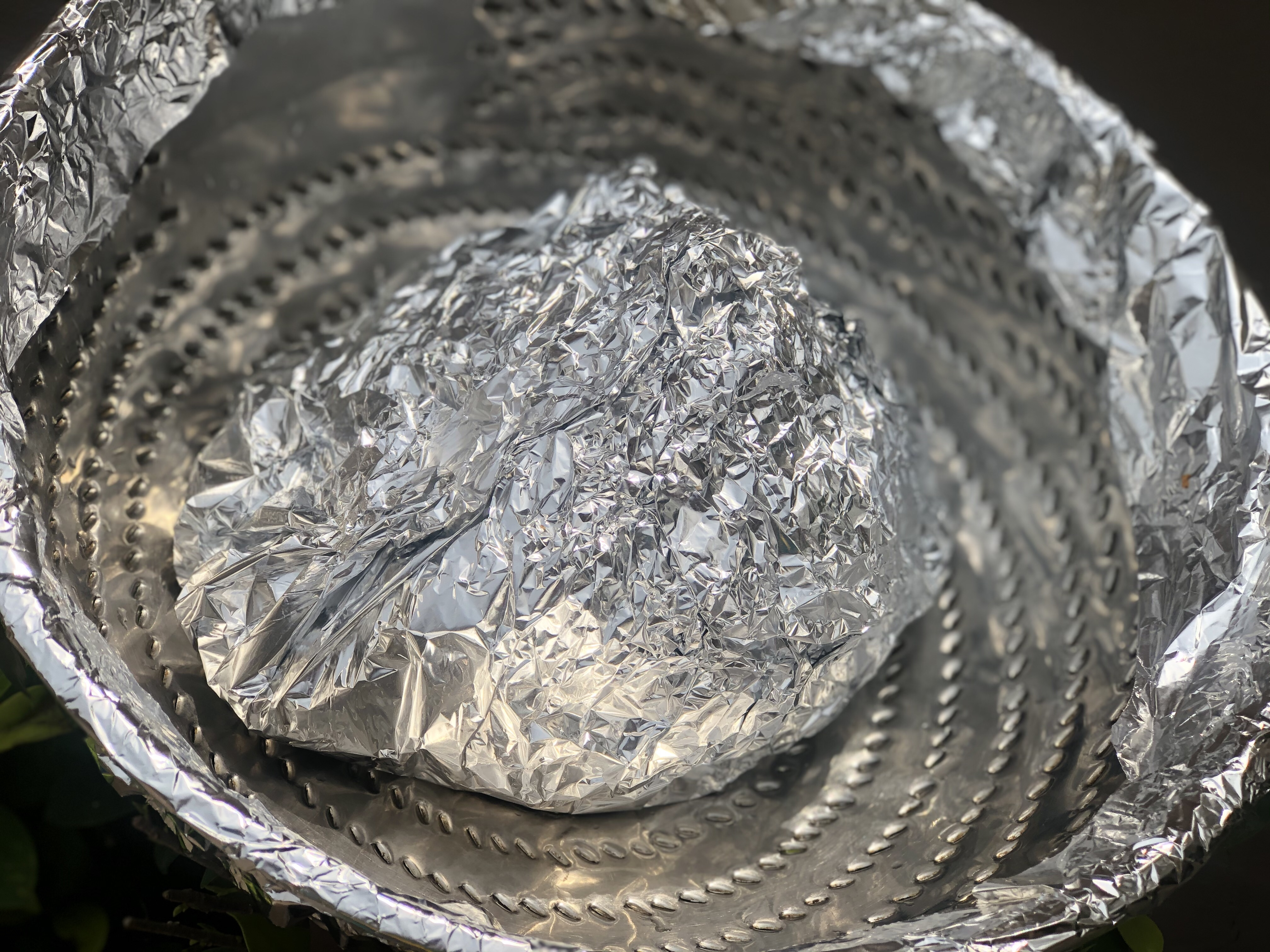 Foil wrapped marinated chicken in a steamer