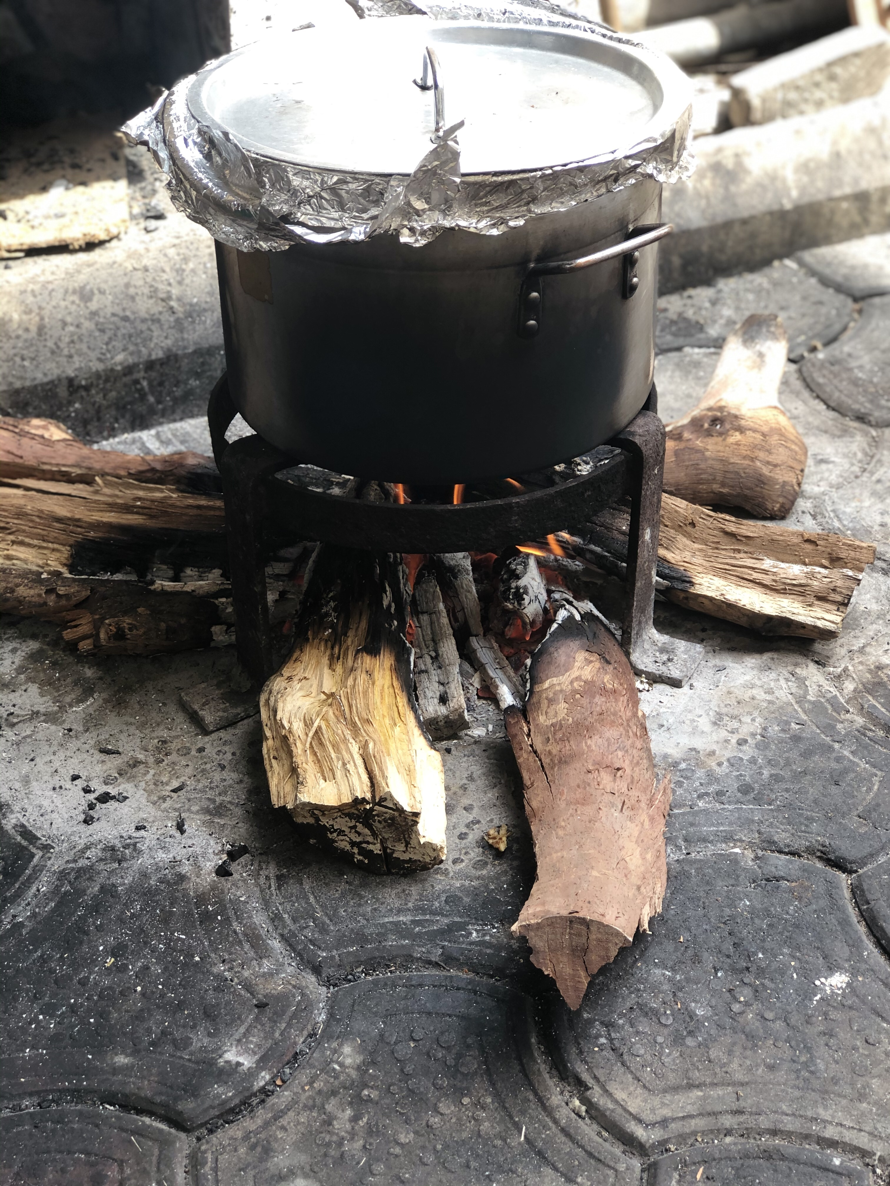 Home made steamer on charcoal fire