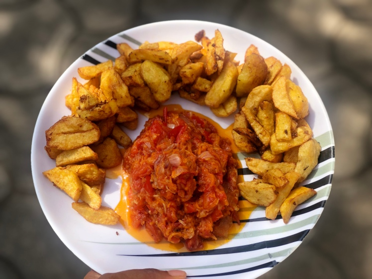 Fried spiced rubbed potatoes with carrot, tomatoes, onions and garlic sauce