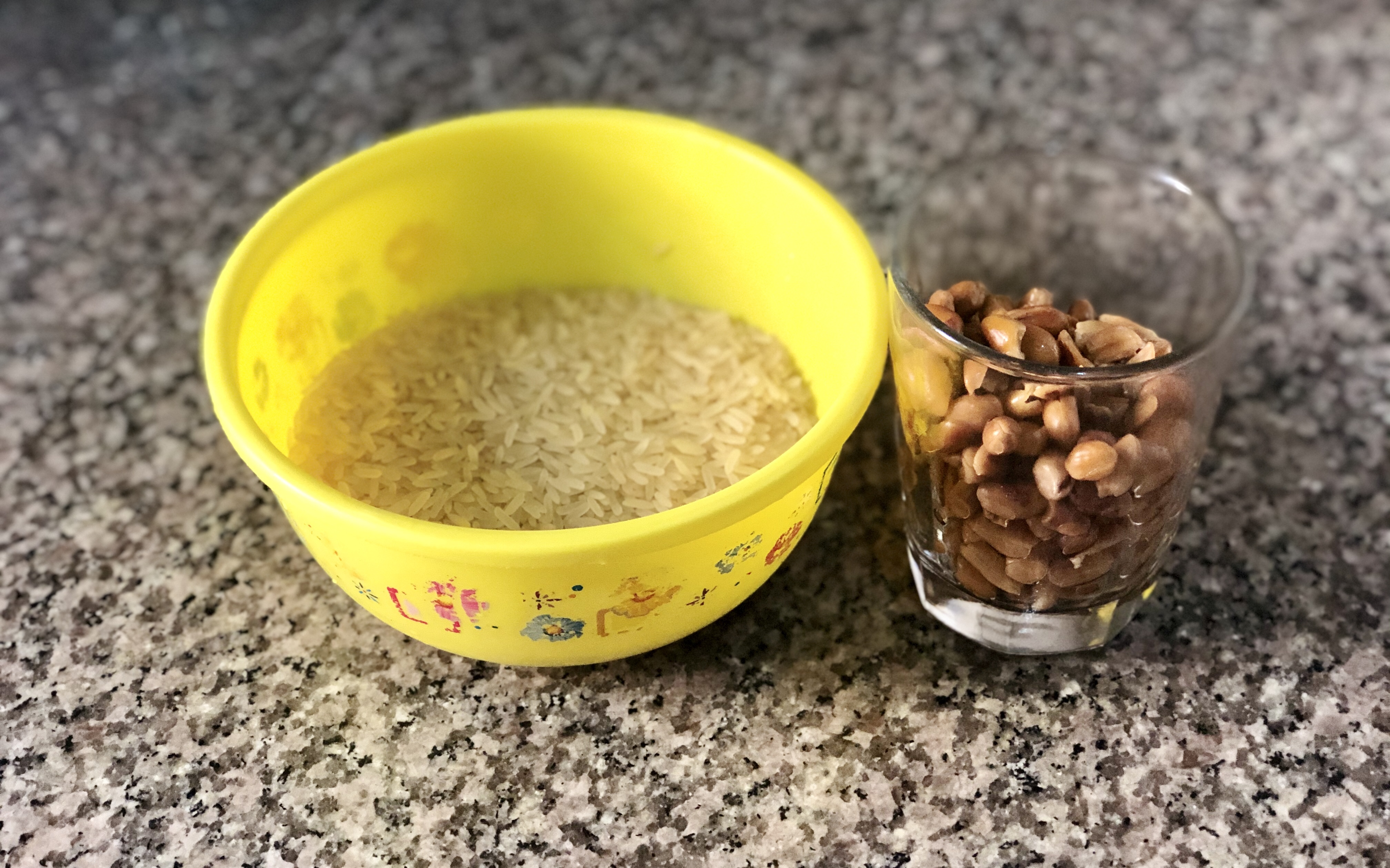 A cup of rice and a cup of roasted peanut